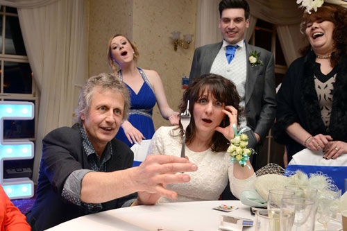 Wedding guest mesmorised by magician